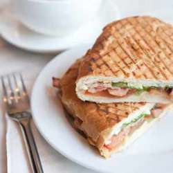 A panini and coffee